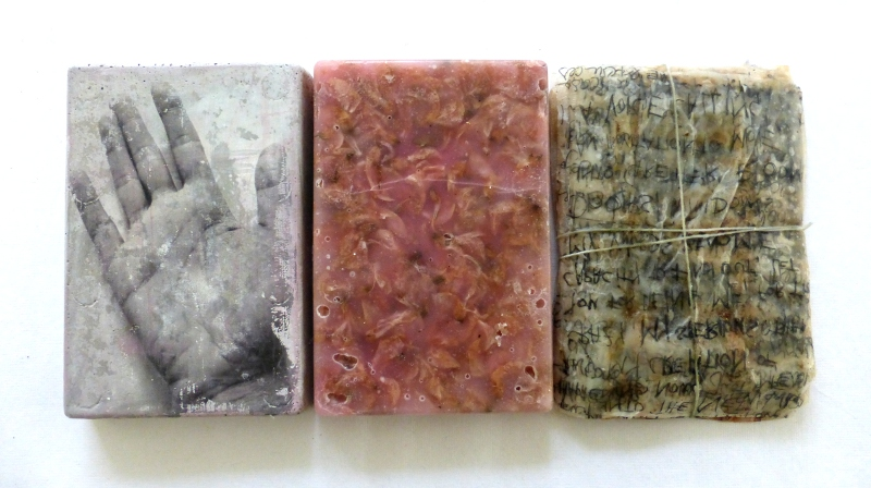 verses, unsung. concrete, wax, dried blossoms, teabags and other material. Ines Seidel