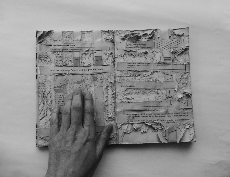 knowledge, sedimented. photograph with altered math text book. Ines Seidel.